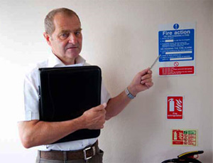 Image of a man checking Fire Safety Stickers